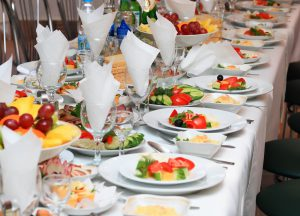A beautifully set table for meal at a wedding reception