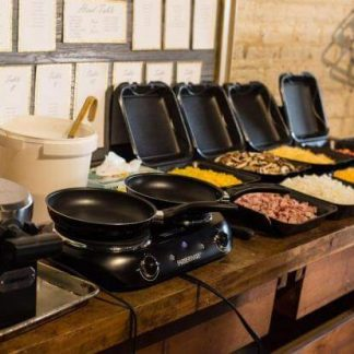 omellette and waffle station on a counter