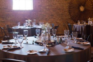 wine glasses, and table decor for a contemporary place setting at a modern wedding venue