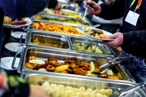 a large buffet of catered food at a party