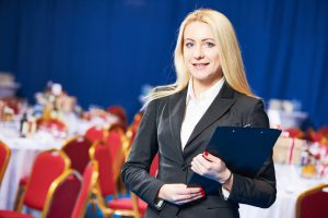 Restaurant manager or catering administrator at event