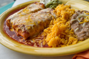 Authentic Mexican enchiladas with sour cream jalapeno and cilantro
